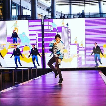 Man dancing on a runway stage