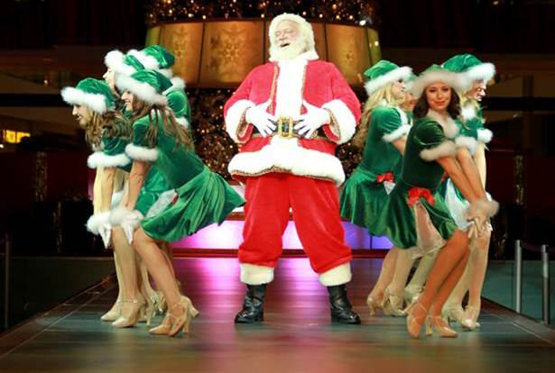 Santa performing on stage with back up dancers